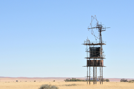 Historical old windpump next to the C13 road near Helmeringhausen in Namibia photo