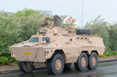 BLOEMFONTEIN, SOUTH AFRICA - February 2014  The Armed Forces parade the streets of Bloemfontein on February 21st, 2014 to commemorate World Armed Forces Day  Ratel infantry fighting vehicle drive by