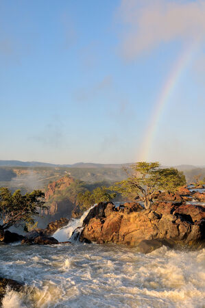 Top of of the Ruacana waterfalls on the border of Namibia and Angola at sunrise photo