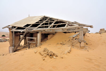 kolmanskop: Ruin of a house at Kolmanskop near Luderitz in Namibia Stock Photo