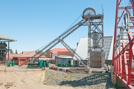 headgear: Headframe (also known as a gallows frame, winding tower, hoist frame, pit frame, shafthead frame, headgear, headstock or poppethead) at the historical Big Hole, diamond mine, Kimberley, South Africa