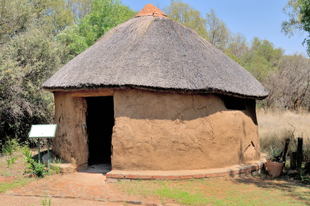 mud house: Traditional Sotho hut built by the indigenous Sotho tribe. Walls built from tree stumps covered with mud and dung. Roof thatched with a species of Hyparrhenia Editorial