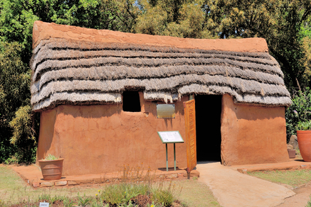 mud house: Hartebeeshuis, literally translated means Hartebeest house. Built by early Europian settlers. Walls built from reeds covered with mud and dung. Roof thatched with a species of Hyparrhenia