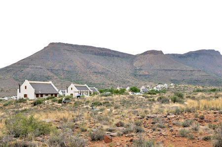 BEAUFORT WEST, SOUTH AFRICA - DECEMBER 2014: Unidentified people on the fossil trail in the Karoo National Park. Chalets in the rest camp is visible.