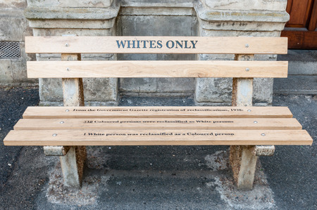 CAPE TOWN, SOUTH AFRICA - DECEMBER 18TH, 2014: Reconstructed apartheid bench in front of the High Court building explaining the race re-classification act of 1938 Editöryel