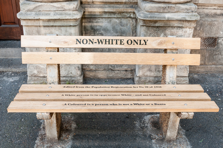 CAPE TOWN, SOUTH AFRICA - DECEMBER 18TH, 2014: Reconstructed apartheid bench in front of the High Court building explaining the race classification from the Population Registration Act no. 30 of 1950
