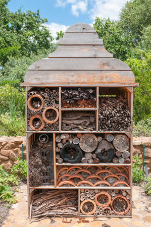 pollinate: CAPE TOWN, SOUTH AFRICA - DECEMBER 21, 2014: Insect hotel on a farm near Paarl in the Western Cape Province of South Africa. It is used as nest for useful insects to control pests and pollinate plants