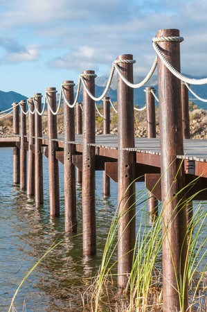 wood pillars: Dam with jetty near Somerset West in the Western Cape Province of South Africa Stock Photo