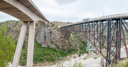 africa: GOURITZ RIVER, SOUTH AFRICA - DECEMBER 26, 2014: The new and old road bridges over the Gouritz River between Riversdale and Mosselbay in the Western Cape Province of South Africa. The train bridge is visible to the far right
