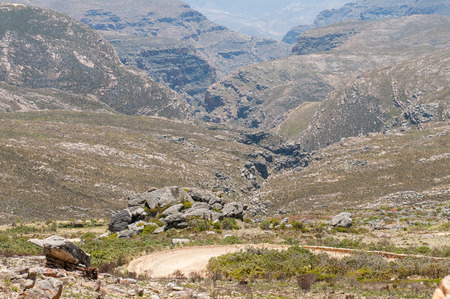 inhospitable: Inhospitable valleys of the arid Swartberg (Black Mountain) as seen from the top of the pass. The pass is a declared national Stock Photo
