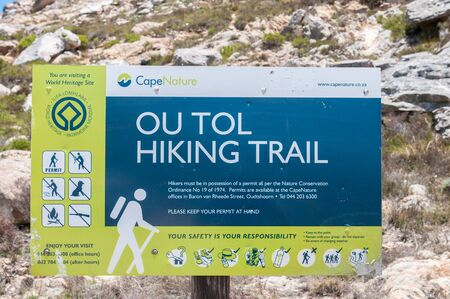 ou: SWARTBERG PASS, SOUTH AFRICA - JANUARY 2, 2015: Ou Tol Hiking Trail sign in the historic Swartberg (Black Mountain) Pass.