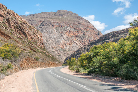 inhospitable: Meiringspoort where the road follows a scenic route cut by the Groot River through the  Swartberg (Black Mountain), crossing the river 25 times