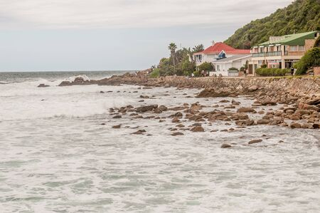suid: GEORGE, SOUTH AFRICA - JANUARY 3, 2015: Unidentified people in front of holiday homes at Victoria Bay