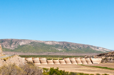 absorption: WILLOWMORE, SOUTH AFRICA - JANUARY 6, 2015: The Beervlei Dam in the Groot River near  Willowmore was built in 1957 to provide flood absorption Editorial
