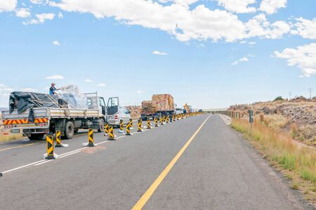 road works: BEAUFORT WEST, SOUTH AFRICA - DECEMBER 1, 2014: A typical sight on South African Roads - stop and go delays at road works Editorial