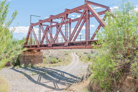 south africa soil: Railway bridge next to the Blockhouse. Blockhouse used by the British troups to defend the bridge during the second Boer War 1899-1902.