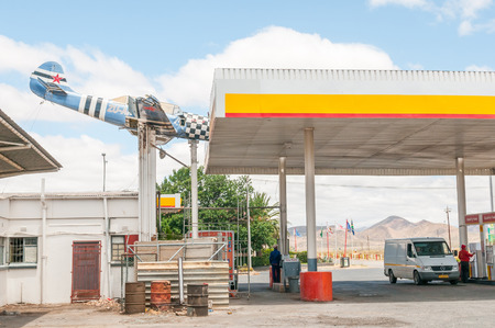 2 way: TOUWS RIVER, SOUTH AFRICA - DECEMBER 2, 2014: An aeroplane wreck mounted in such a way as if it hit the roof at a local gas station Editorial