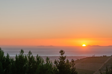 Sun setting across False Bay with Gordons Bay visible in front and Cape Point middle left photo