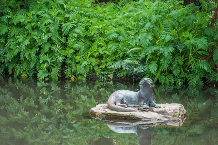 newlands: CAPE TOWN, SOUTH AFRICA - DECEMBER 9, 2014: Sculpture of an otter in the Kirstenbosch Botanical Gardens