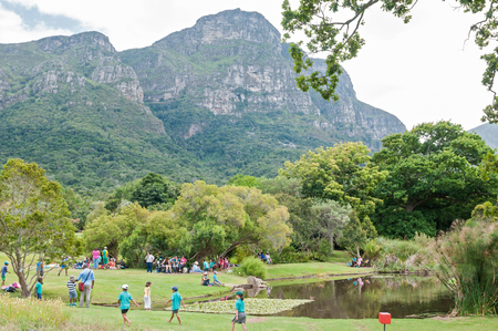 CAPE TOWN, SOUTH AFRICA - DECEMBER 9, 2014: Unidentified people in the Kirstenbosch National Botanical Gardens with part of Table Mountain visible Editorial