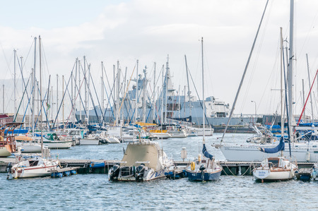 12 class: CAPE TOWN, SOUTH AFRICA - DECEMBER 12, 2014:  Simons Town harbor with a South African Navy Valour class frigate in the background Editorial