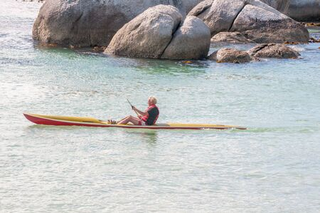 table mountain national park: CAPE TOWN, SOUTH AFRICA - DECEMBER 12, 2014:  Paddling with a canoe at the Boulders section of the Table Mountain National Park in Simons Town
