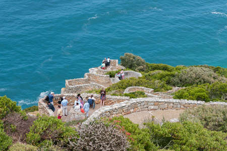 table mountain national park: CAPE TOWN, SOUTH AFRICA - DECEMBER 12, 2014:  Unidentified tourists enjoying the view at Cape Point