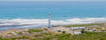 snake head: CAPE TOWN, SOUTH AFRICA - DECEMBER 12, 2014:  Panorama of the Slangkop (snake head) Lighthouse at Kommetjie