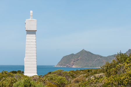 whittle: Monument near Cape Point visible in back commemorate voyage around the Cape by Vasco da Gama in 1497. Serves as beacon helping ships avoid Whittle Rock Stock Photo