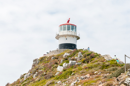 table mountain national park: CAPE TOWN, SOUTH AFRICA - DECEMBER 12, 2014:  Historic lighthouse at Cape Point in the Table Mountain National Park in Cape Town, South Africa. In operation from 1860-1919