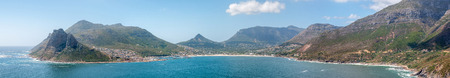chapmans: Panorama of Hout Bay harbor and town. Chapmans Peak Drive is visible to the right