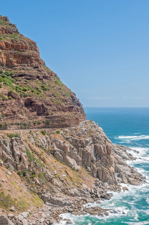 scenic drive: Chapmans Peak a scenic drive between Noordhoek and Hout Bay. Nets to catch falling rocks are visible Stock Photo