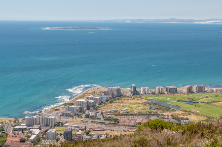 robben island: CAPE TOWN SOUTH AFRICA  DECEMBER 18 2014: Sea Point and Robben Island as seen from Signal Hill in Cape Town Editorial