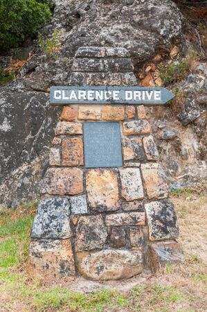 els: CAPE TOWN SOUTH AFRICA  DECEMBER 23 2014: Weathered memorial stone remembering the person after which Clarence Drive between Gordons Bay and Rooi Els was named