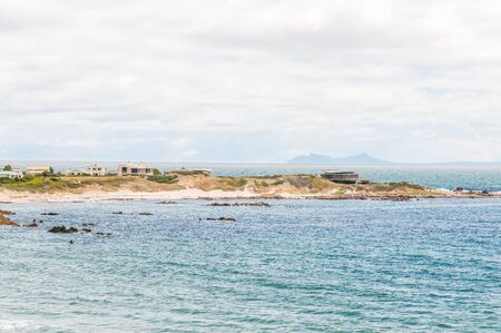 els: Part of Rooi Els town between Gordons Bay and Kleinmond with Cape Point in the distance accross False Bay Stock Photo