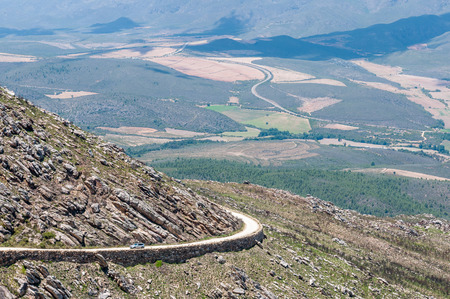south africa soil: SWARTBERG PASS SOUTH AFRICA  JANUARY 2 2015: View from the Swartberg Pass to the East showing farms down in the valley. The pass is a declared national monument.