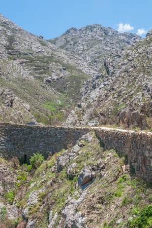 declared: SWARTBERG PASS SOUTH AFRICA  JANUARY 2 2015: Built out part of the historic Swartberg Black Mountain Pass showing the intricate stonework. The pass is a declared national monument. Editorial