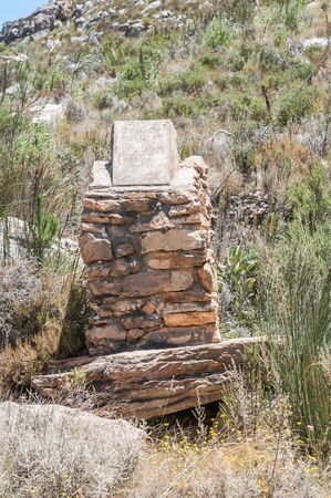 SWARTBERG PASS SOUTH AFRICA  JANUARY 2 2015: Weathered memorial to the visit of an oxwagon named Magrieta Prinsloo in 1938 to celebrate the centenary of the Big Trek