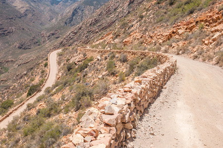 declared: One of the hairpin bends in the historic Swartberg Black Mountain Pass. The pass is a declared national monument. Stock Photo