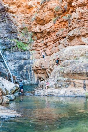 MEIRINGSPOORT SOUTH AFRICA  JANUARY 2 2015: An unidentified visitor jumping into the pool below the waterfall