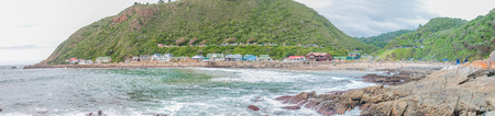 GEORGE SOUTH AFRICA  JANUARY 4 2015: Unidentified people holiday homes and a caravan park at the beach at Victoria Bay Editorial
