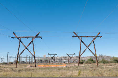 northern african: KIMBERLEY SOUTH AFRICA  APRIL 5 2015: Electricity infrastructure against the backdrop of a mine dump