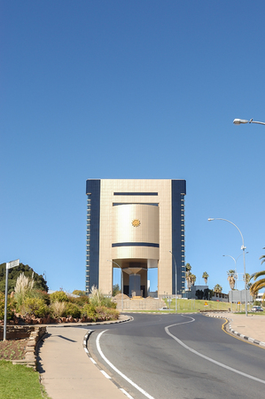 alte: WINDHOEK, NAMIBIA - JUNE 9, 2012:  The Independence Memorial next to the Alte Feste, the oldest building in Windhoek