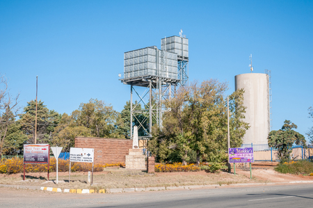 reservoirs: REDDERSBURG, SOUTH AFRICA - APRIL 26, 2015: Water reservoirs in a Street scene in Reddersburg in the Free State Province of South Africa