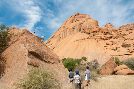 spitzkoppe: SPITZKOPPE, NAMIBIA - JUNE 5, 2011: Unidentified rock climbers at a camp site at Spitzkoppe