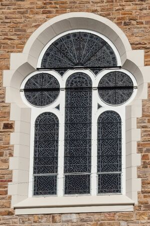 lutheran: WINDHOEK, NAMIBIA - JUNE 9, 2012: A window of the historic Christuskirche, a German Lutheran church in Windhoek, Namibia, inaugerated on October 16, 1910 Editorial