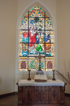 luderitz: LUDERITZ, NAMIBIA - JUNE 14, 2011: A stained glass window in the Lutheran Felsenkirche rock church on Diamond Hill, consecrated in 1912 Editorial