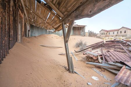 kolmanskop: Historic old building at the ghost town of Kolmanskop near Luderitz, Namibia.