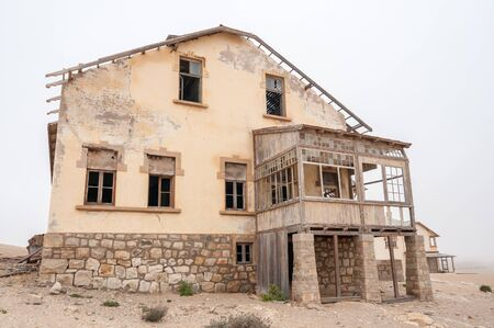 luderitz: An historic old building at the ghost town of Kolmanskop near Luderitz, Namibia. Stock Photo