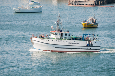 luderitz: LUDERITZ, NAMIBIA - JUNE 15, 2011: A fisheries research vessel leaving Luderitz harbor on a research trip